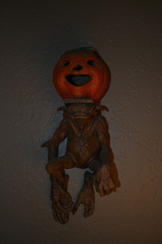 A gargoyle with a pumpkin on its head. You're welcome.