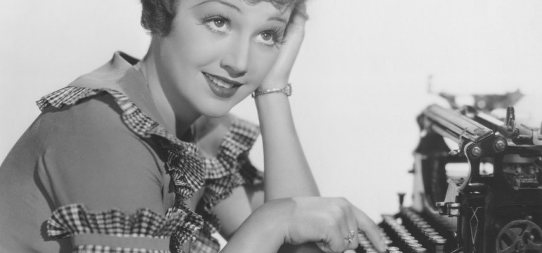 cropped-lady-at-typewriter